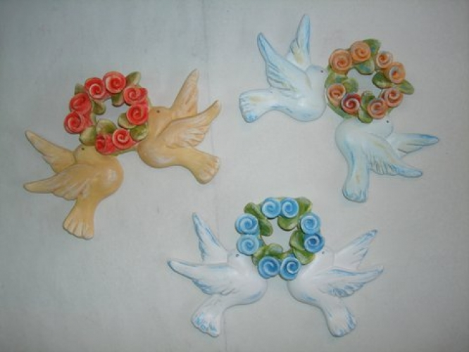 Hand-painted ceramic pigeons with wreath.