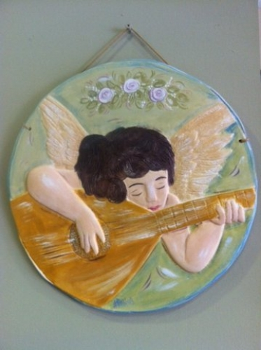 Hand-painted Ceramic Repousse plate.