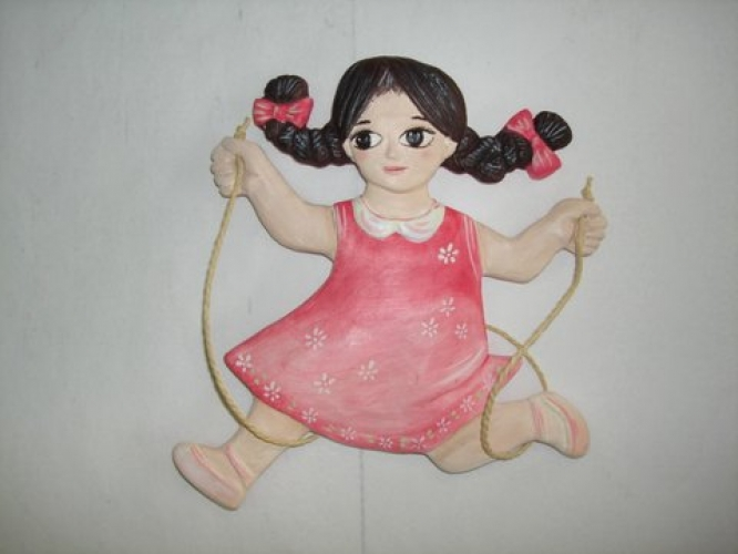 "Handmade ceramic figurine ""little girl playing""."