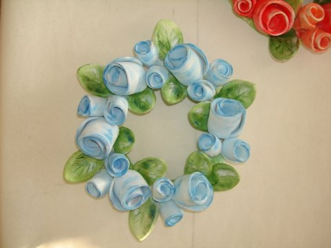 Hand-painted ceramic wreath.