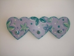 "Hand-painted wooden hanger ""3 hearts""."
